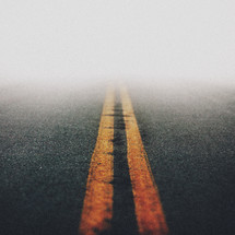 fog over center lines on a road