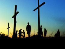 silhouettes of youth around crosses