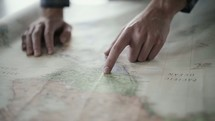 a man looking at a map planning a trip