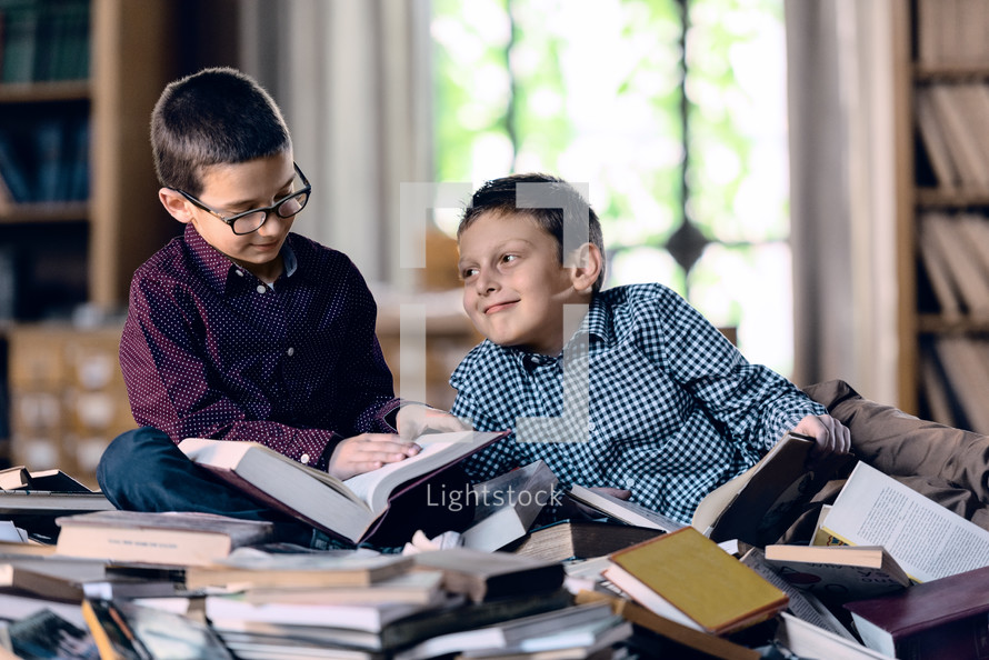 children reading on a stack of books