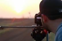 Photographer at sunset.