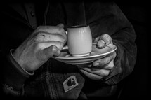 man drinking an espresso