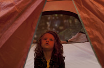 a girl in a tent