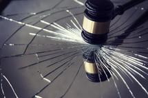 gavel breaking glass.