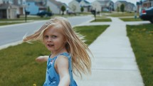 happy child spinning outdoors
