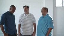 a group of men talking