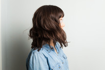 side profile of a brunette woman