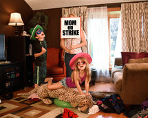 wild kids in a messy house and mom on strike