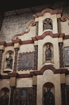 statues and paintings of saints in a cathedral