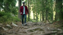 Man walking in forest and turning around