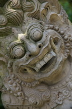 Stone carving of evil face of Indonesian deity