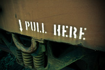 Pull Here and arrow sign on the side of a box car