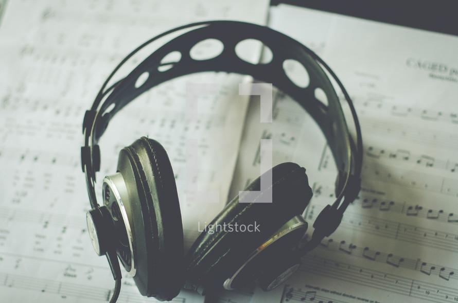 headphones on sheet music