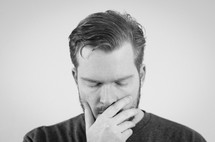 a man with closed eyes praying