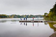 people on a lake dock