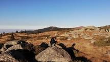 man on a mountaintop praying