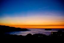 shoreline silhouette at sunset