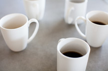 circle of coffee mugs