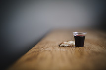 wine and bread on table for communion