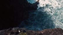 Wave crashing hard against the cliff
