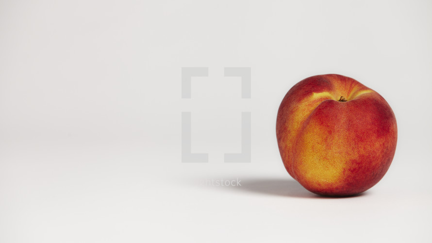 A peach isolated on white