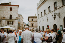 people gathered in a town square