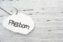 fish hook on paper with the word freedom