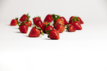 A group of red strawberries isolated on white