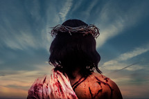 Jesus wearing a crown of thorns with wounds on his back