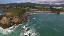 Aerial Video of Ocean Rock Formation and Coastal Town