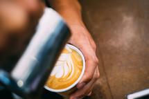 heart shaped creamer in a latte