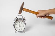 taking a hammer to an alarm clock