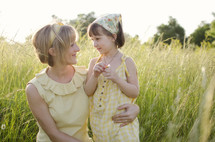 Mother and daughter in grass field