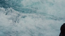 Waves crashing against the rocks