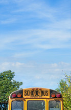 School Bus against a blue sky.