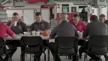 firefighters eating at a table