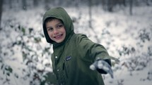 a kid throwing a snowball