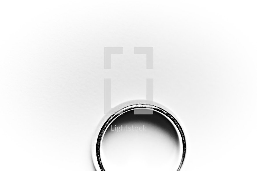 A husband's wedding band or ring isolated on white