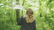 A woman walking through the woods