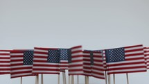 spinning American flags on sticks