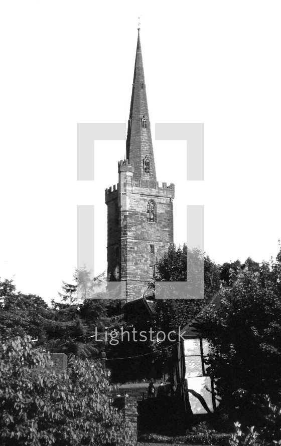 a stone tower and steeple on an English Church