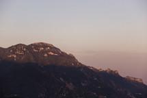 sunlight on a mountain peak in Italy