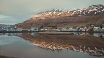 coastal homes along a still bay