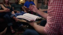 Reading the Bible during a small group Bible study.