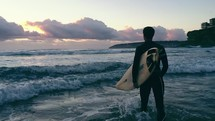 a surfer with a surfboard