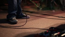 feet of a musician on stage