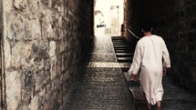 Jesus walking through the streets of Jerusalem