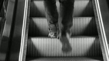 a man walking up escalator stairs
