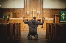 Man praying inside church