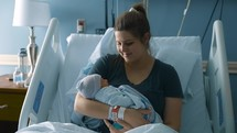 mother in a hospital with a newborn baby